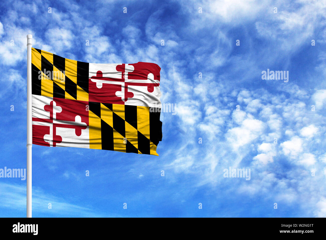 National flag State of Maryland on a flagpole in front of blue sky - Stock Image