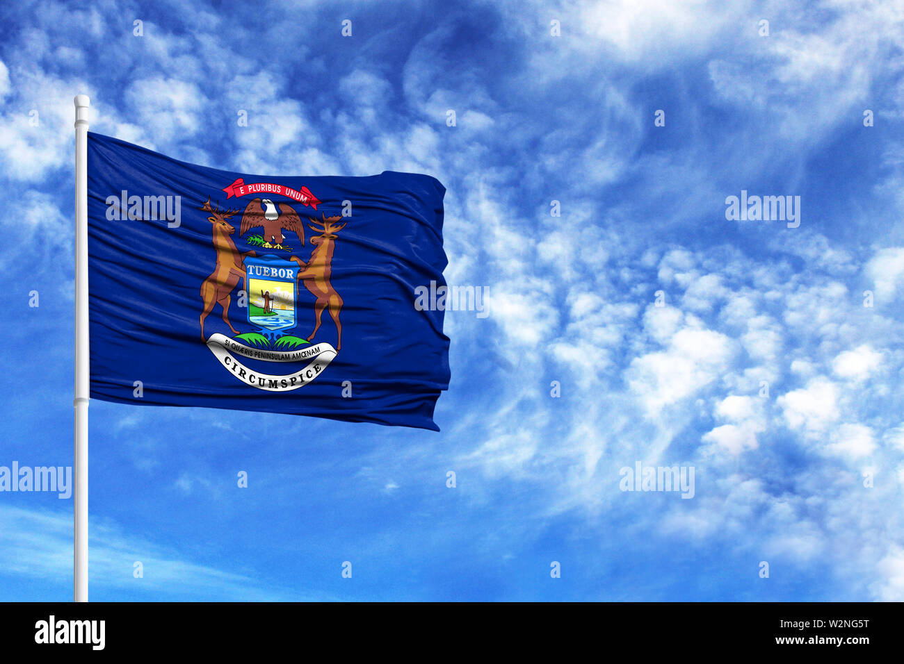 National flag State of Michigan on a flagpole in front of blue sky - Stock Image