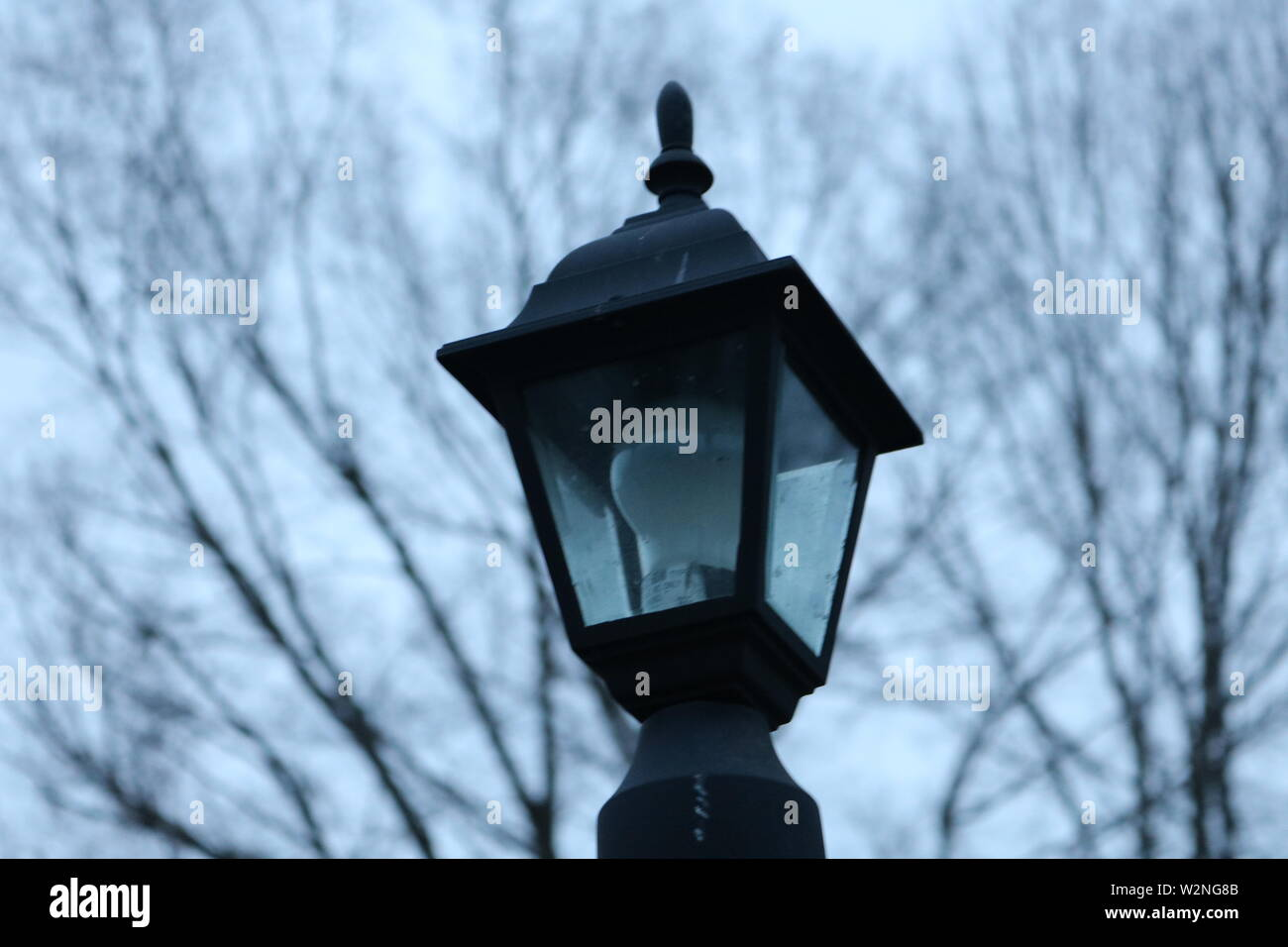 Out side lamp. Photo was taken in the early morning on a cloudy day. - Stock Image
