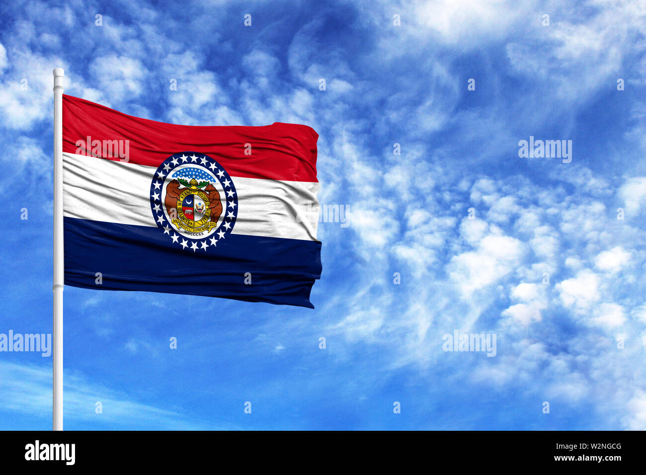 National flag State of Missouri on a flagpole in front of blue sky - Stock Image