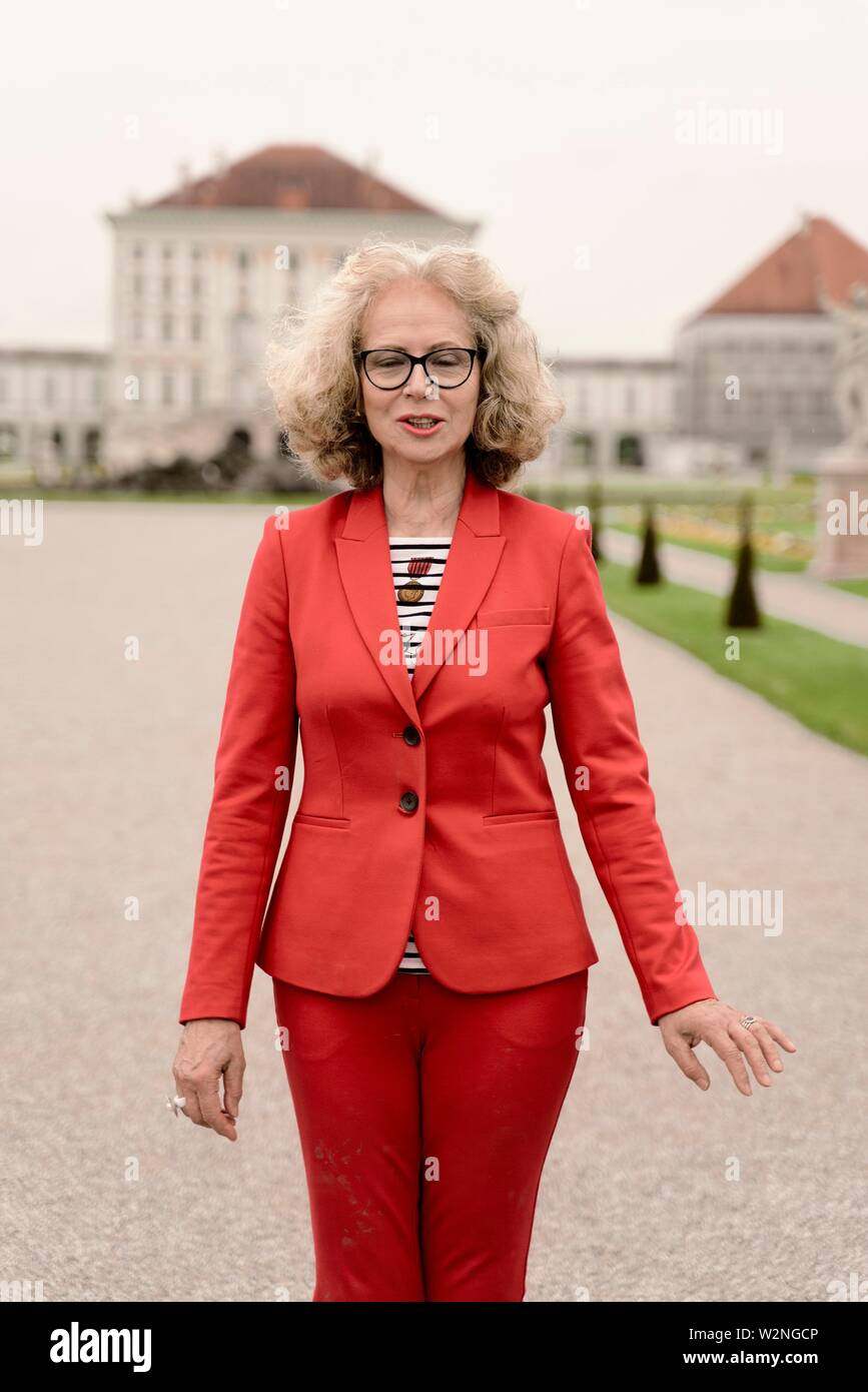 senior woman (67 years old), in Nymphenburg, Munich, Germany. - Stock Image