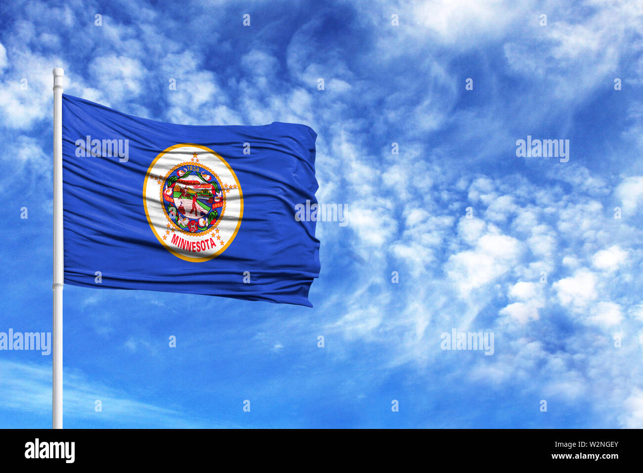 National flag State of Minnesota on a flagpole in front of blue sky - Stock Image