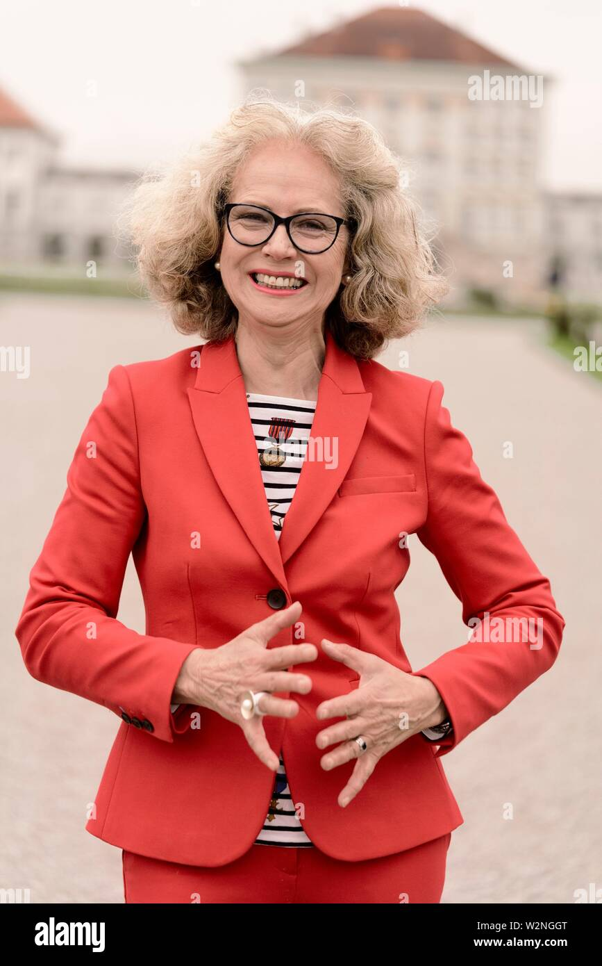 lively senior woman (67 years old), in Nymphenburg, Munich, Germany. - Stock Image