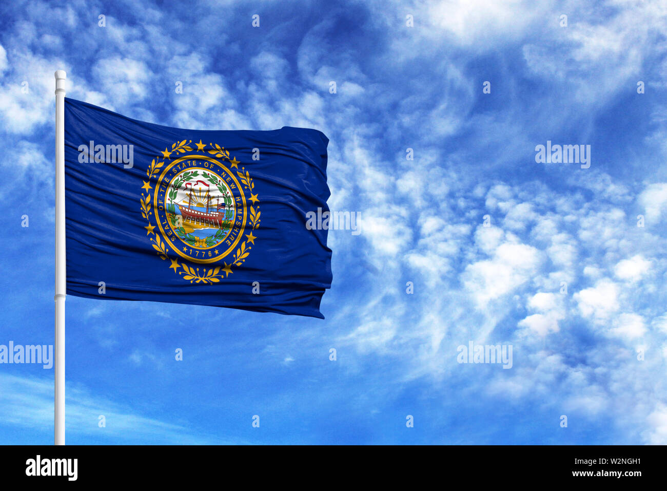 National flag State of New Hampshire on a flagpole in front of blue sky - Stock Image