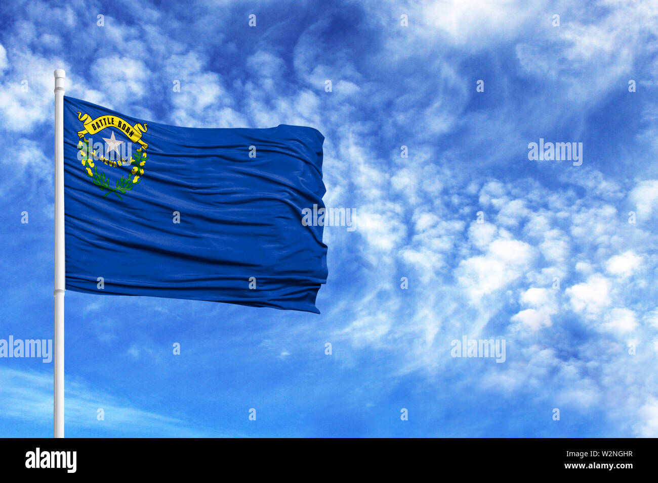 National flag State of Nevada on a flagpole in front of blue sky - Stock Image