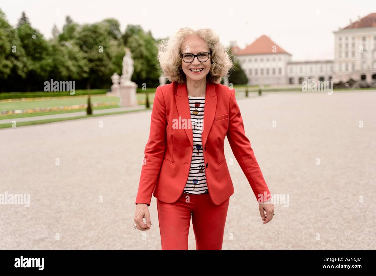smiling senior woman, in Nymphenburg, Munich, Germany. - Stock Image