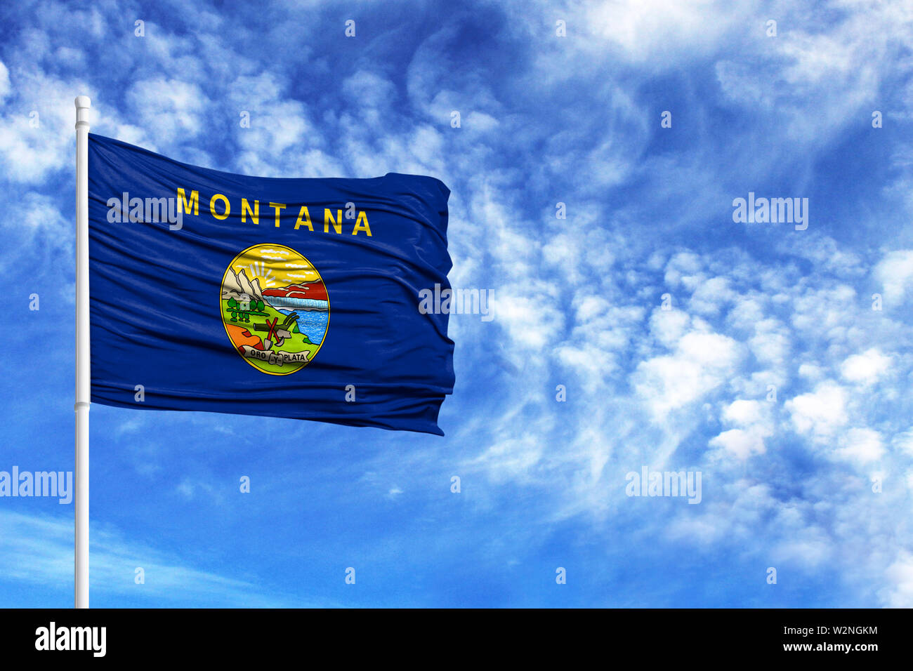 National flag State of Montana on a flagpole in front of blue sky - Stock Image