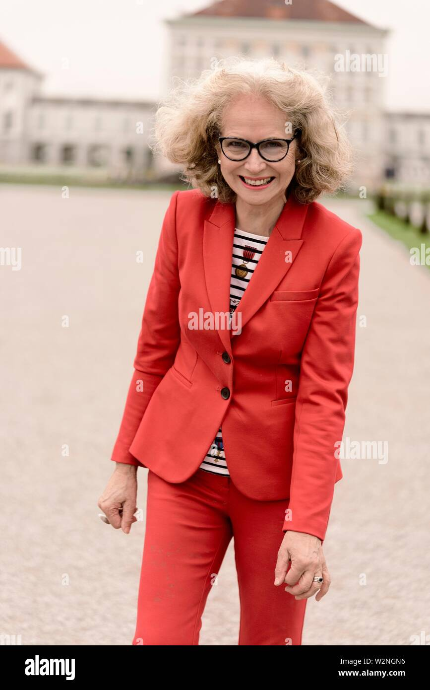 pleased senior woman (67 years old), in Nymphenburg, Munich, Germany. - Stock Image