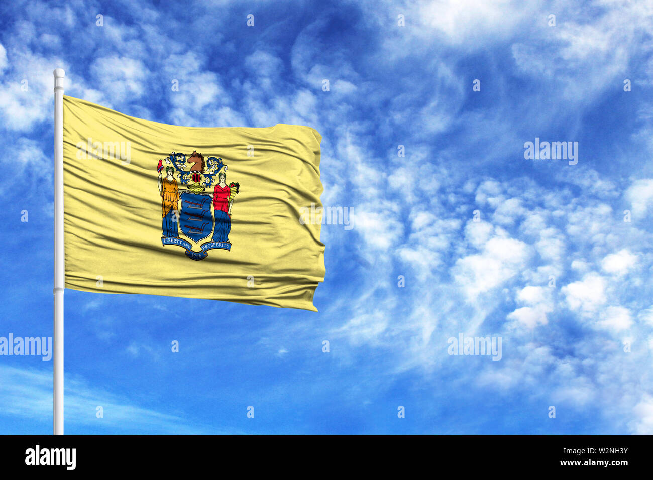 National flag State of New Jersey on a flagpole in front of blue sky - Stock Image
