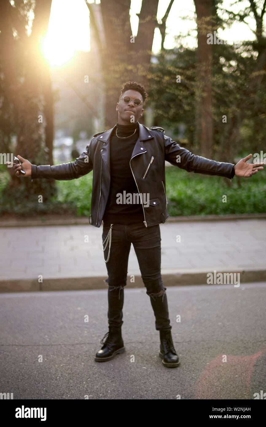 young African man shrugging shoulders - Stock Image