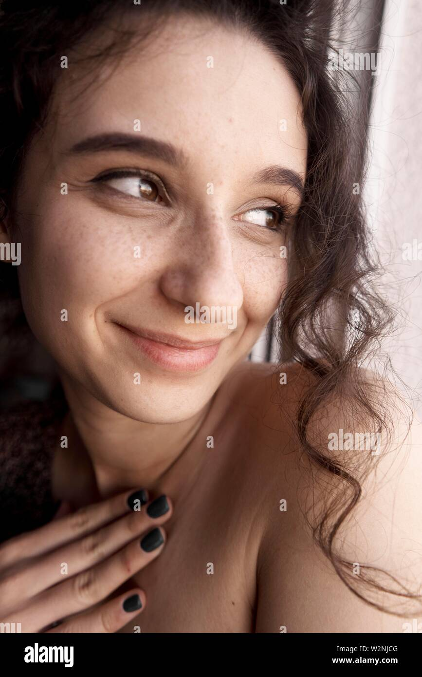 young emotionally touched woman - Stock Image
