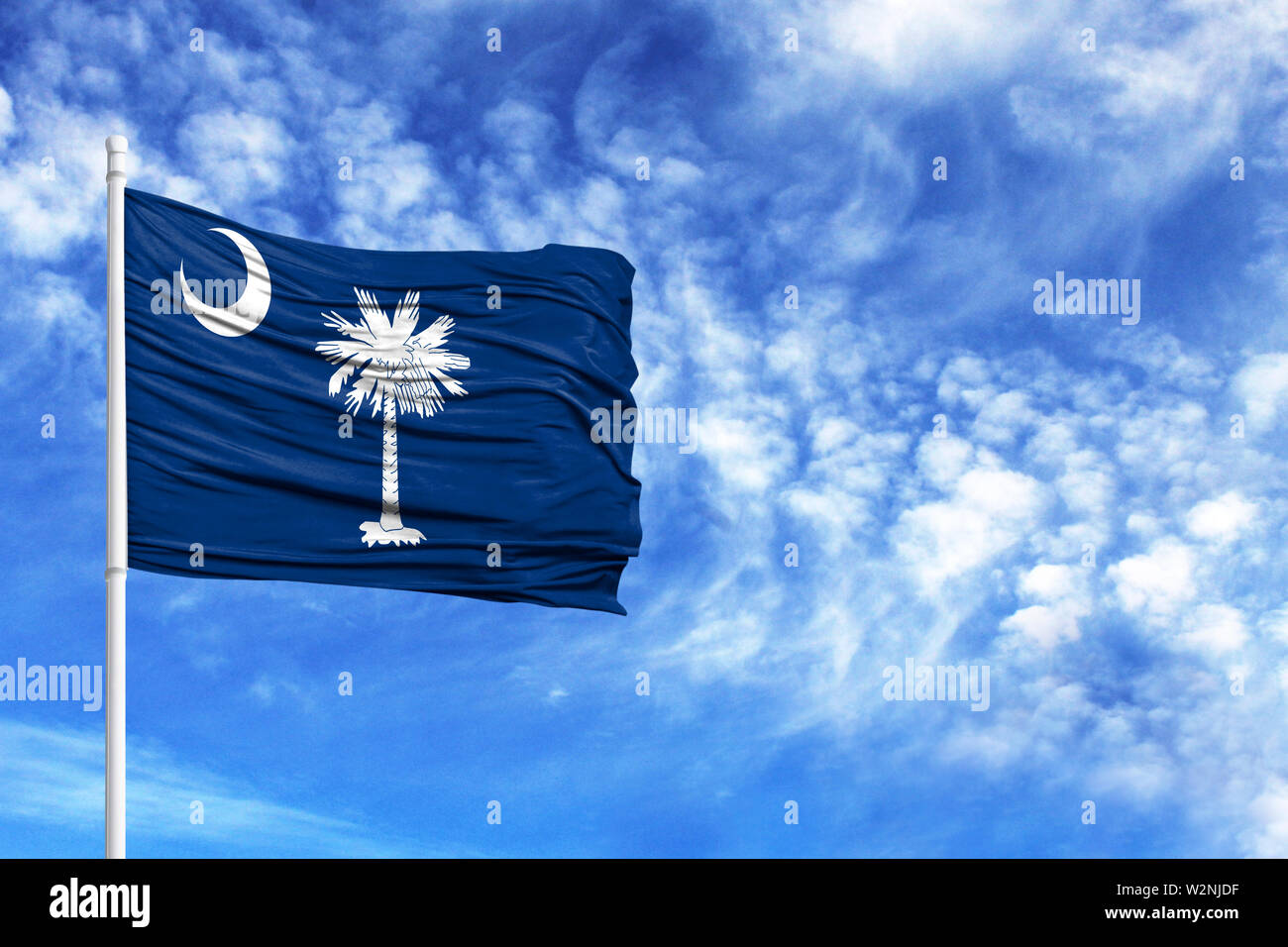 National flag State of South Carolina on a flagpole in front of blue sky - Stock Image