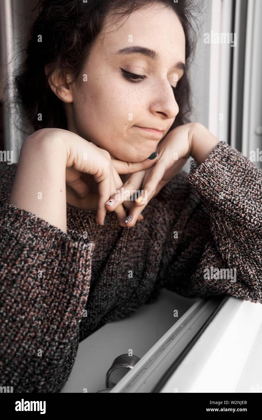 young regretful woman regretting - Stock Image
