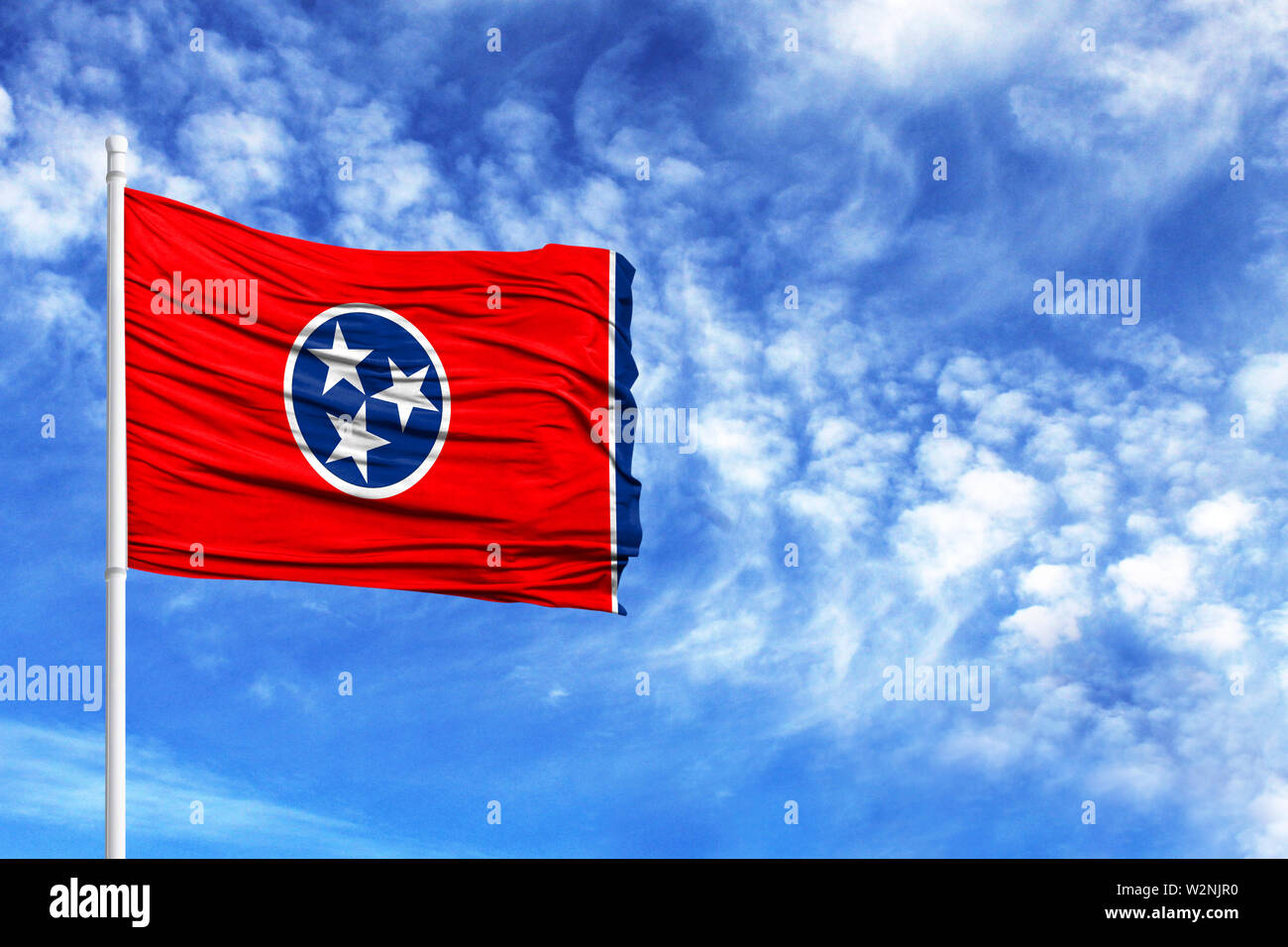 National flag State of Tennessee on a flagpole in front of blue sky - Stock Image