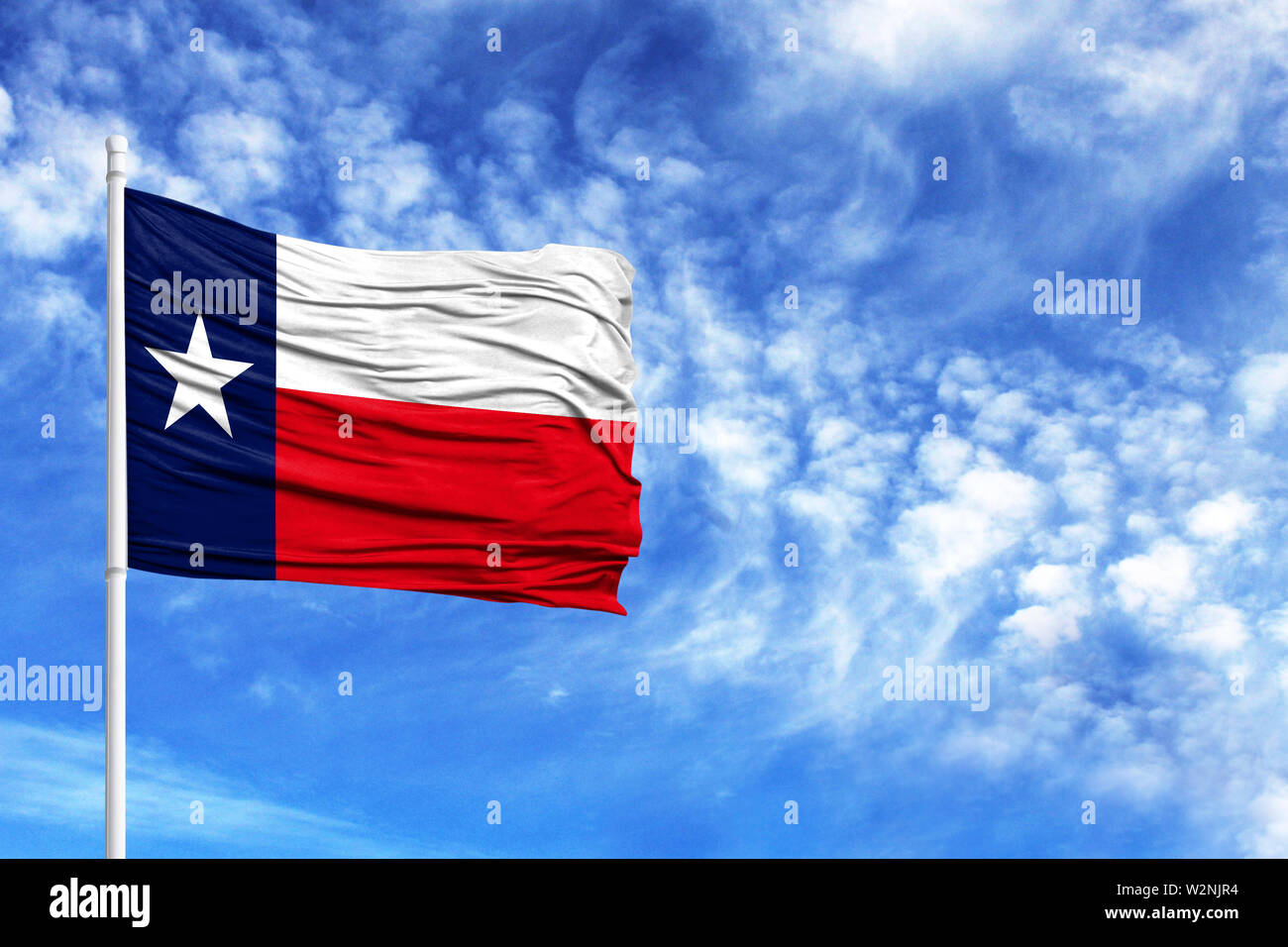 National flag State of Texas on a flagpole in front of blue sky - Stock Image
