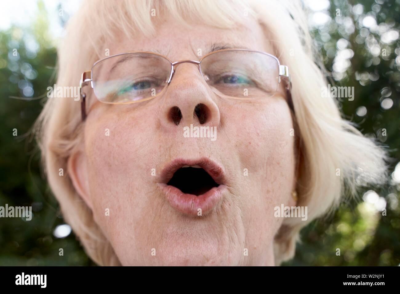 headshot of communicative senior woman speaking - Stock Image