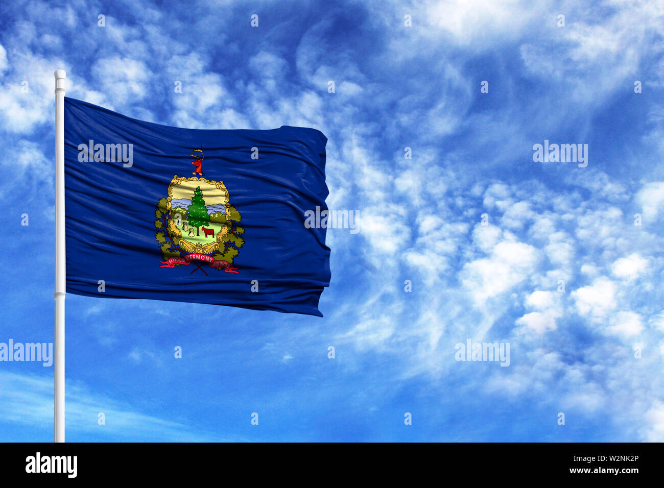 National flag State of Vermont on a flagpole in front of blue sky - Stock Image