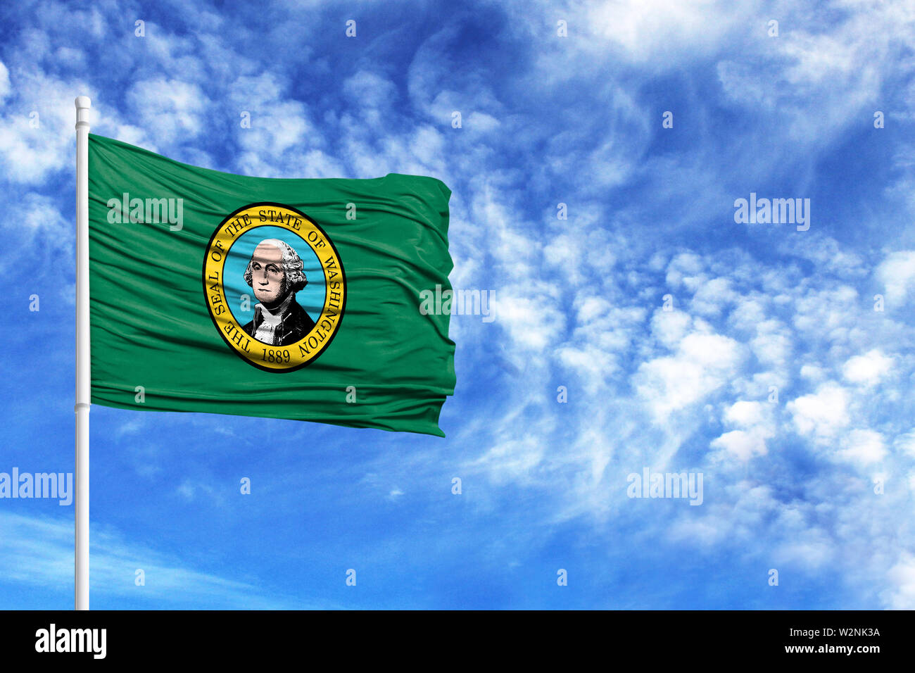 National flag State of Washington on a flagpole in front of blue sky - Stock Image