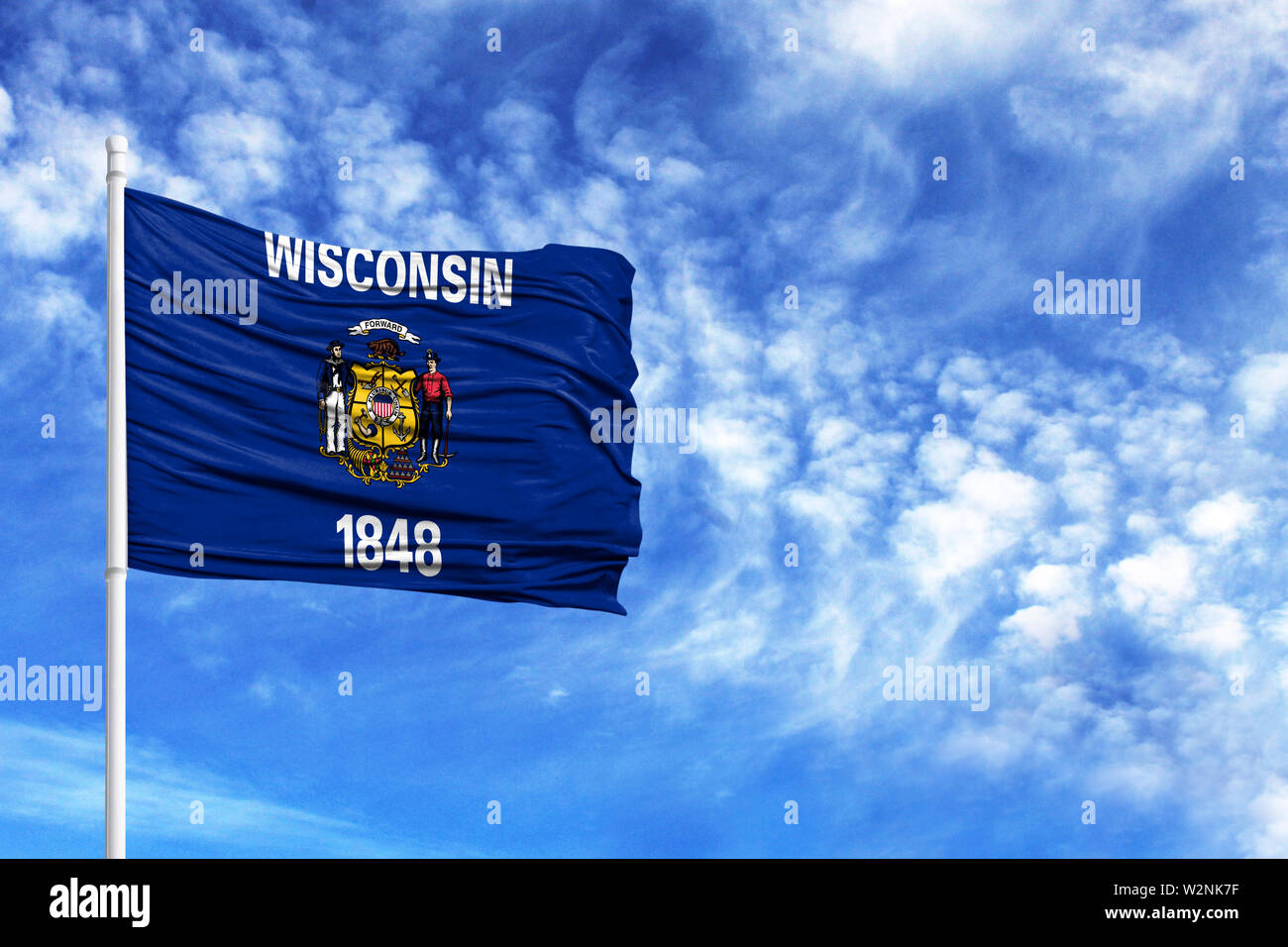 National flag State of Wisconsin on a flagpole in front of blue sky - Stock Image