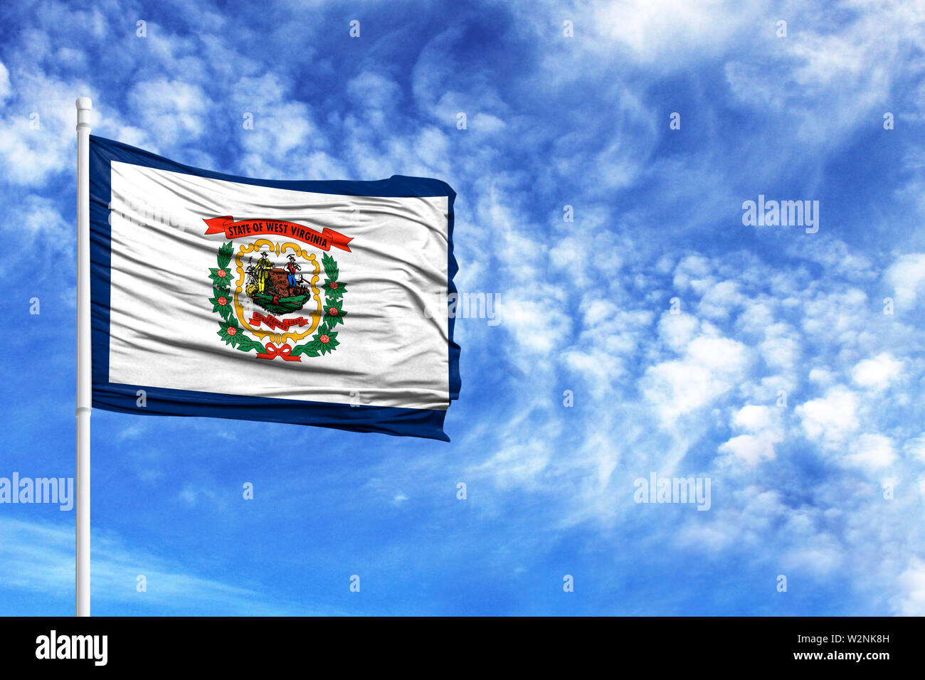 National flag State of West Virginia on a flagpole in front of blue sky - Stock Image