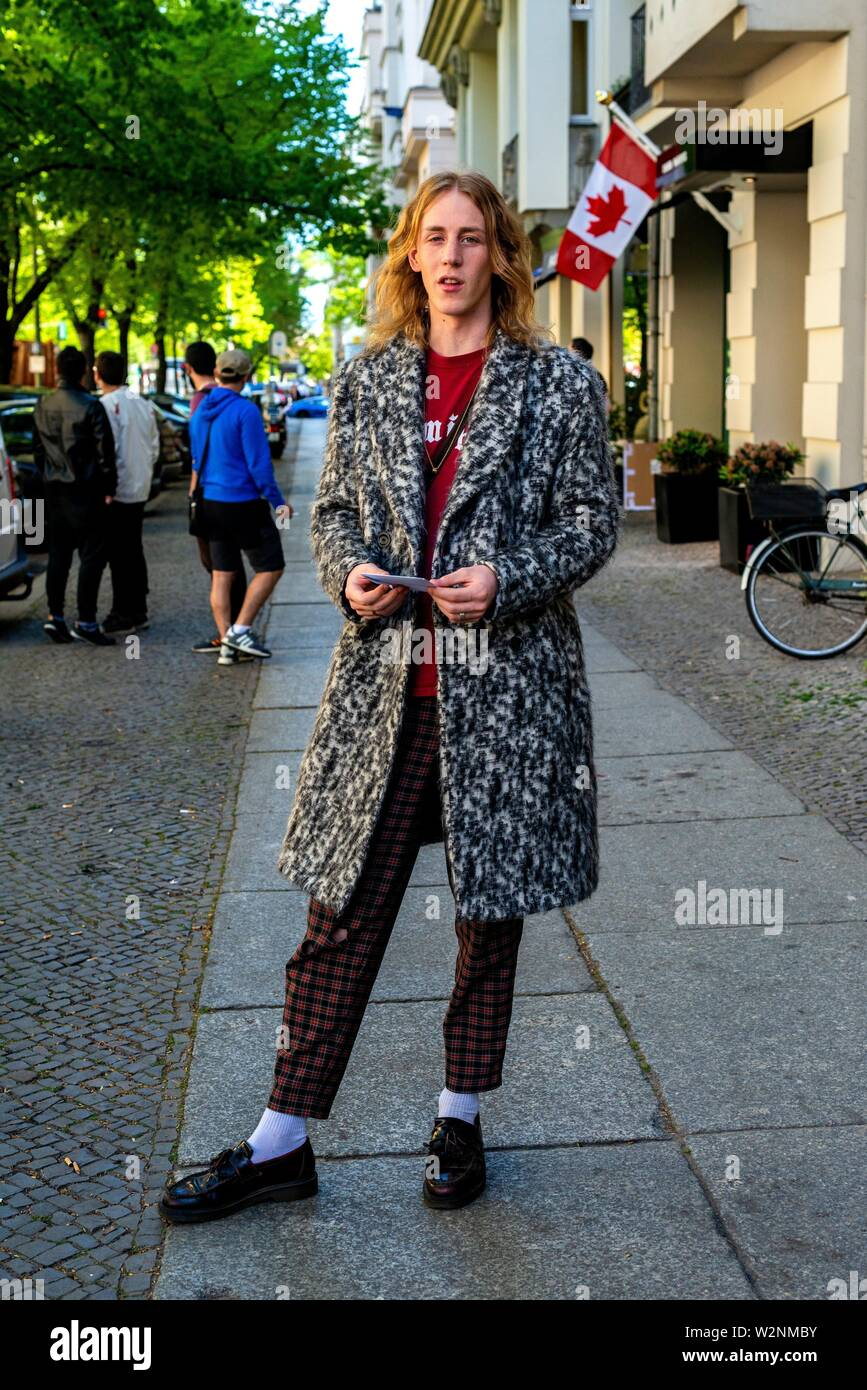 Berlin, Germany. Young, male music student strolling the commercial and fashion shopping district to find new additions to his wardrobe. - Stock Image