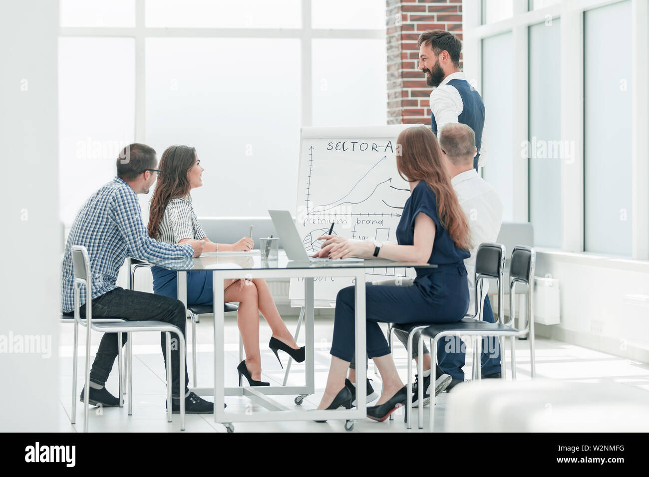 business team holds a meeting in a modern office .photo with copy space - Stock Image