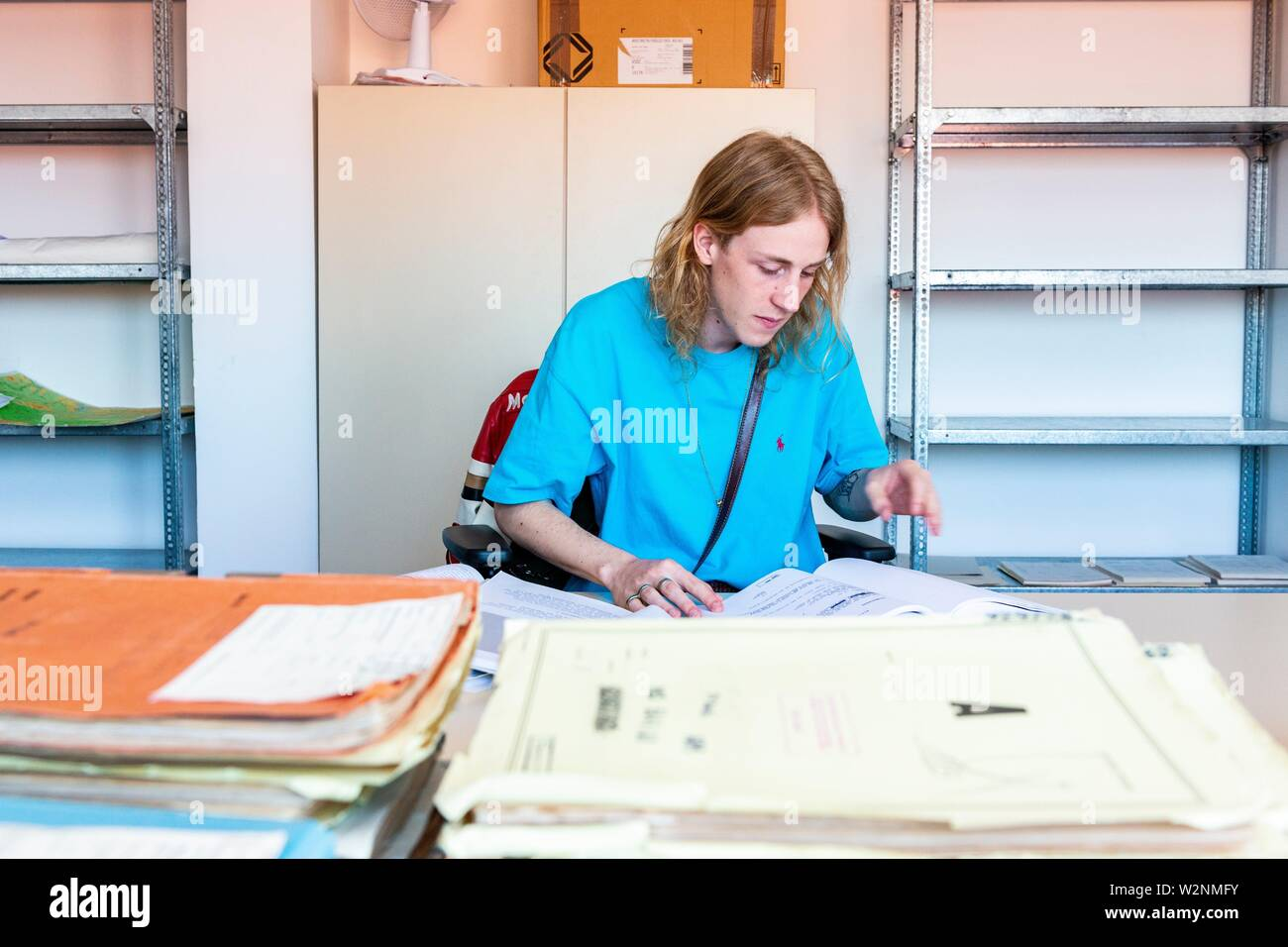 Berlin, Germany. Even young people, born after the Berlin Wall was torn down, are interested to read about and investigate what the MfS Stasi was up - Stock Image
