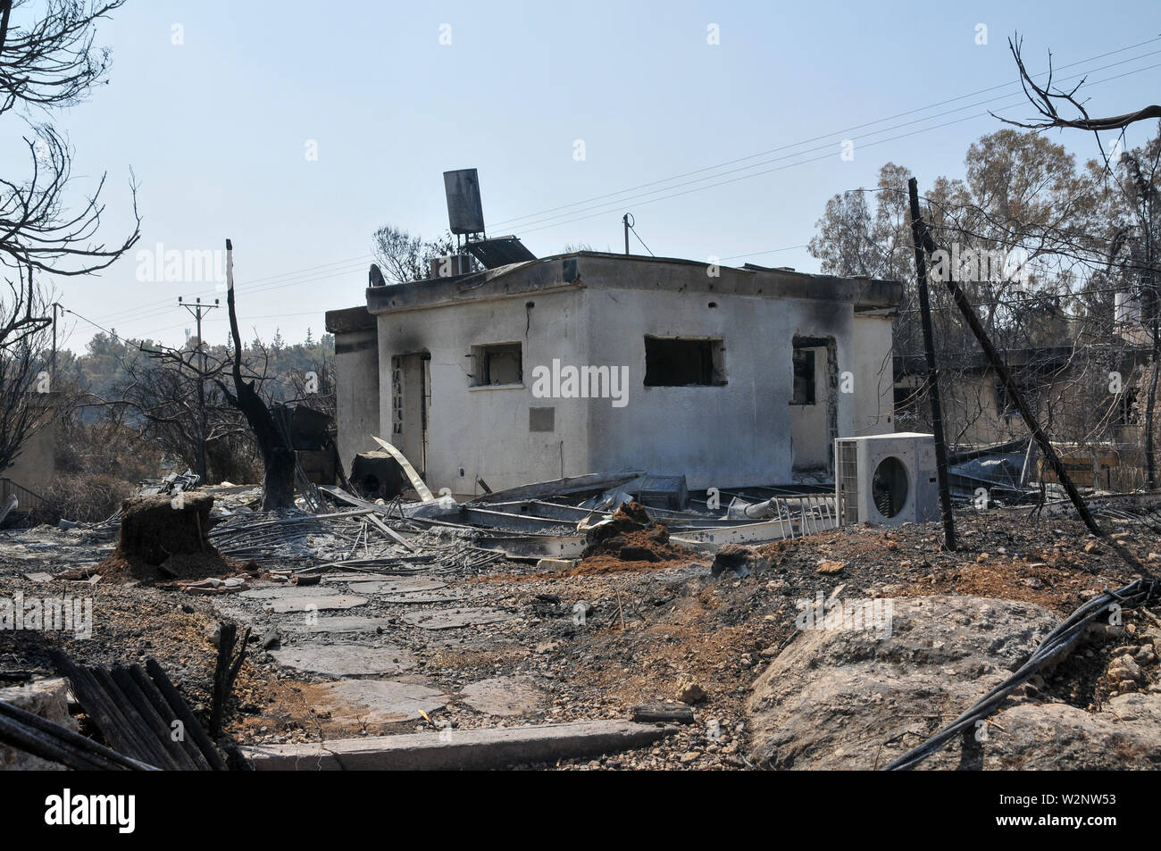 On May 23 2019, a forest fire devastated the village of Mevo Modiim, Israel. Exterior of a burnt home - Stock Image