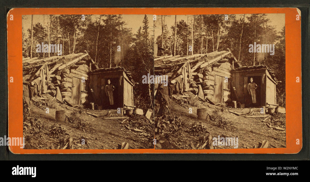(Woman stands in doorway of log cabin) on the Northern Pacific Road, by Childs, B F 2 - Stock Image