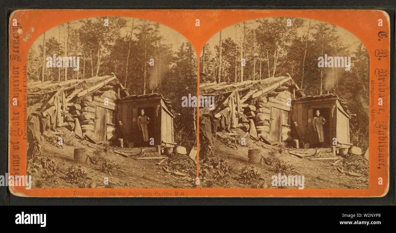 (Woman stands in doorway of log cabin) on the Northern Pacific Road, by Childs, B F - Stock Image
