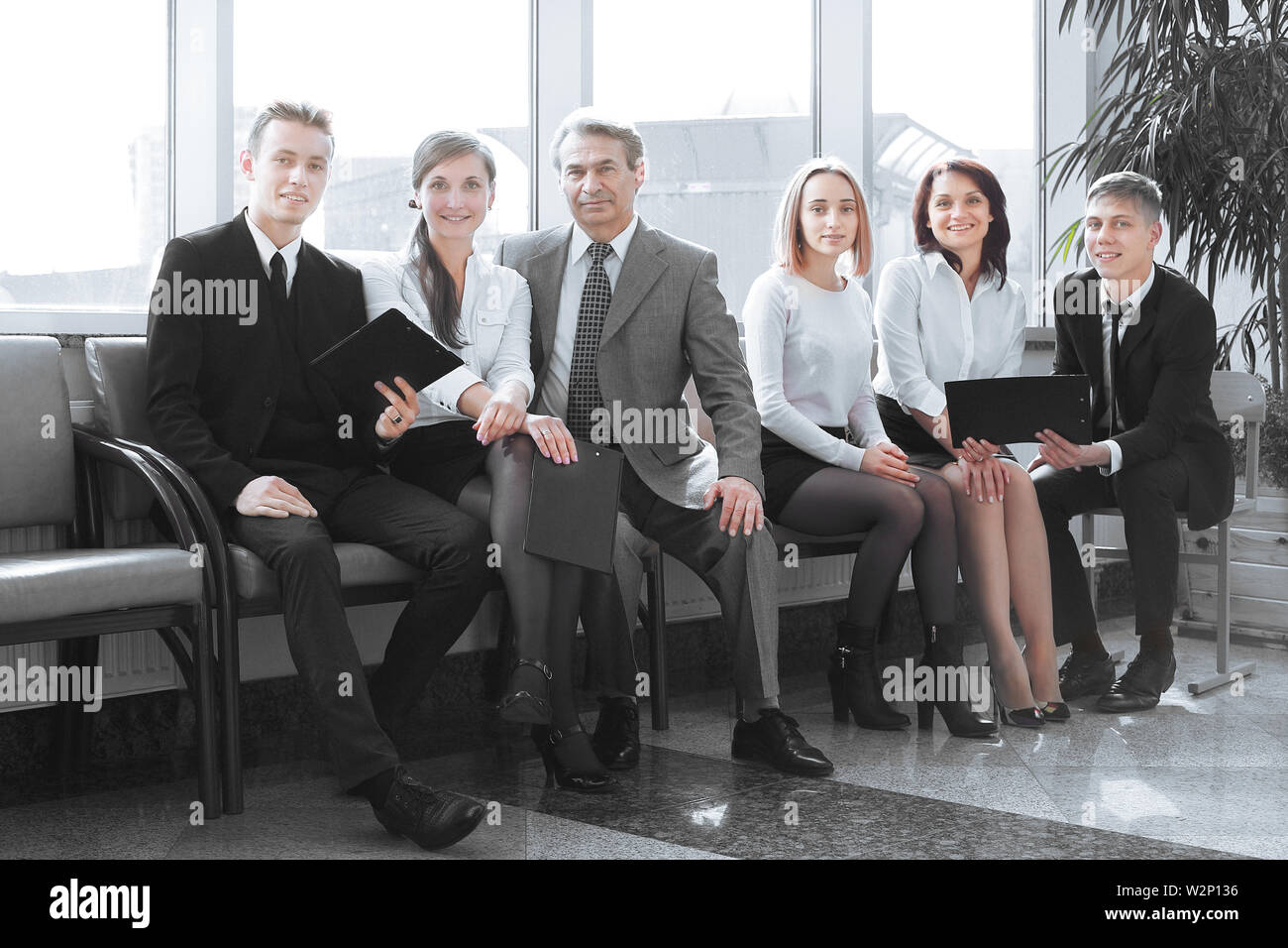 close up.professional business team sitting in the lobby of the office. - Stock Image