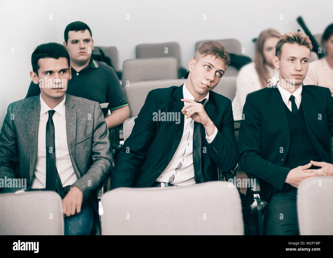 Group of young executives holding a work meeting in a conference room.business and education - Stock Image