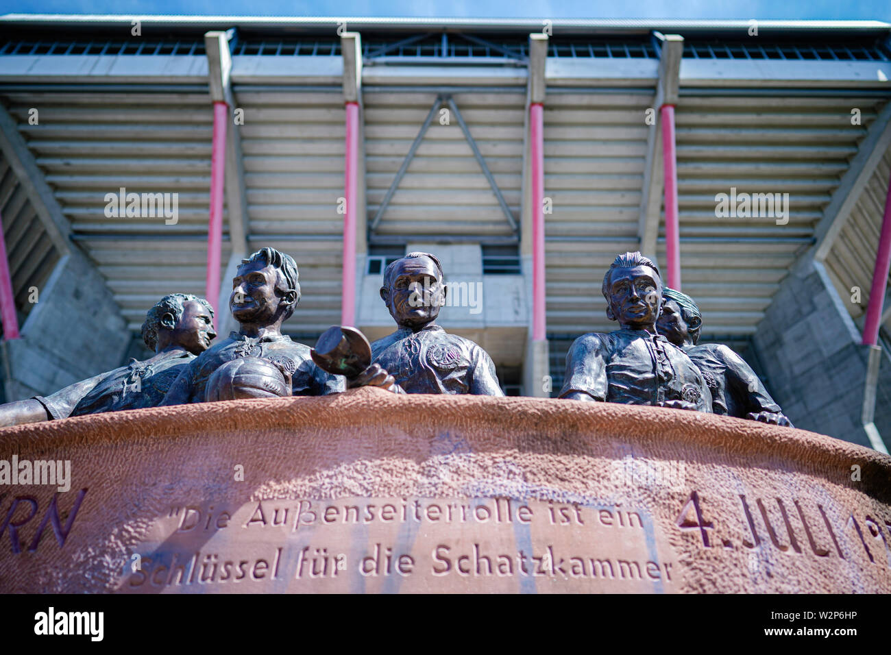Kaiserslautern, Germany. 10th July, 2019. Soccer, 3rd league: 1st FC Kaiserslautern photo session for the 2019/20 season in the Fritz Walter Stadium. A memorial in front of the Horst-Eckel-Tor commemorates the 1954 World Cup players of the DFB team playing for Kaiserslautern at that time. Credit: Uwe Anspach/dpa/Alamy Live News - Stock Image