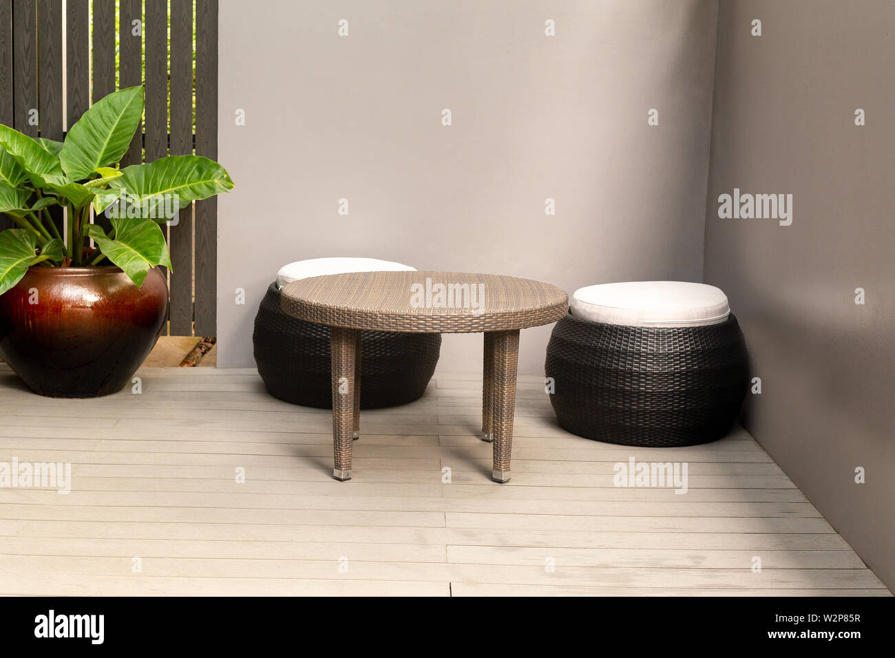 Rattan Corner Round Chair On Wooden Floor And Plant Outdoor Stock Photo Alamy