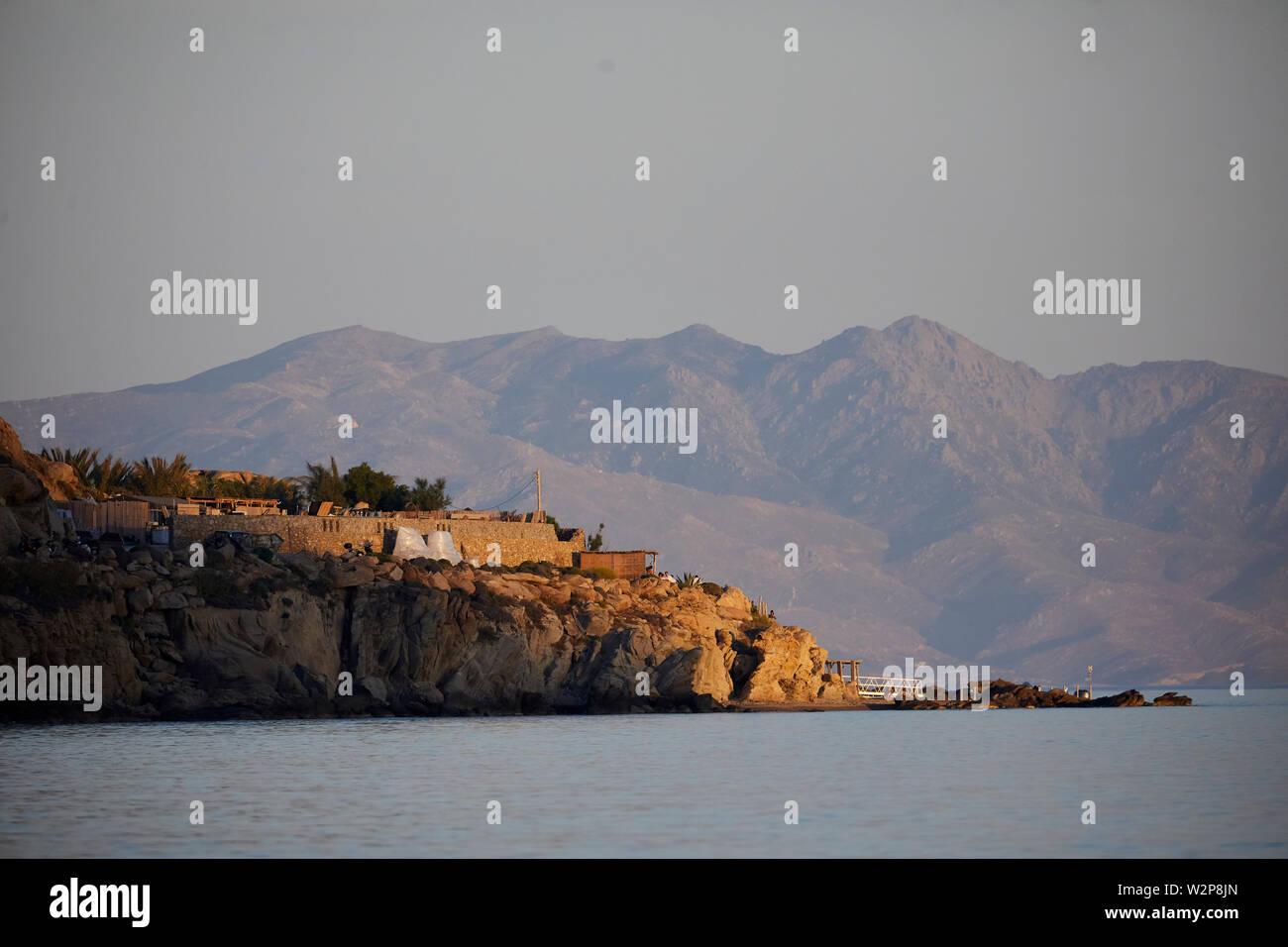 Mykonos, ˈmikonos Greek island, part of the Cyclades, Greece. Platis Gialos with Delos beyond  ? - Stock Image