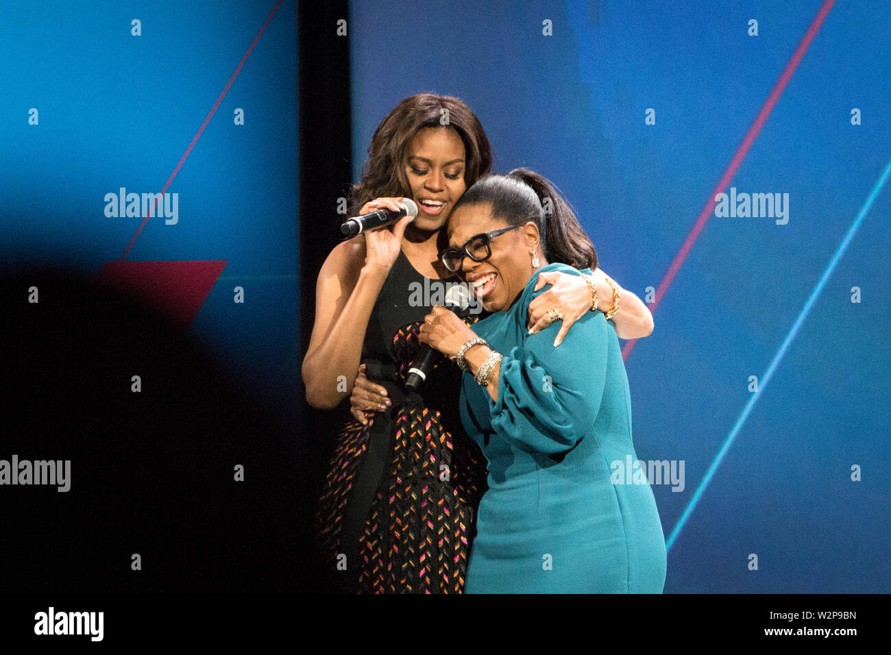 "First Lady Michelle Obama and Oprah Winfrey at the ""United States of Women"" conference at the Walther Washington Convention Center in Washington D.C. Stock Photo"