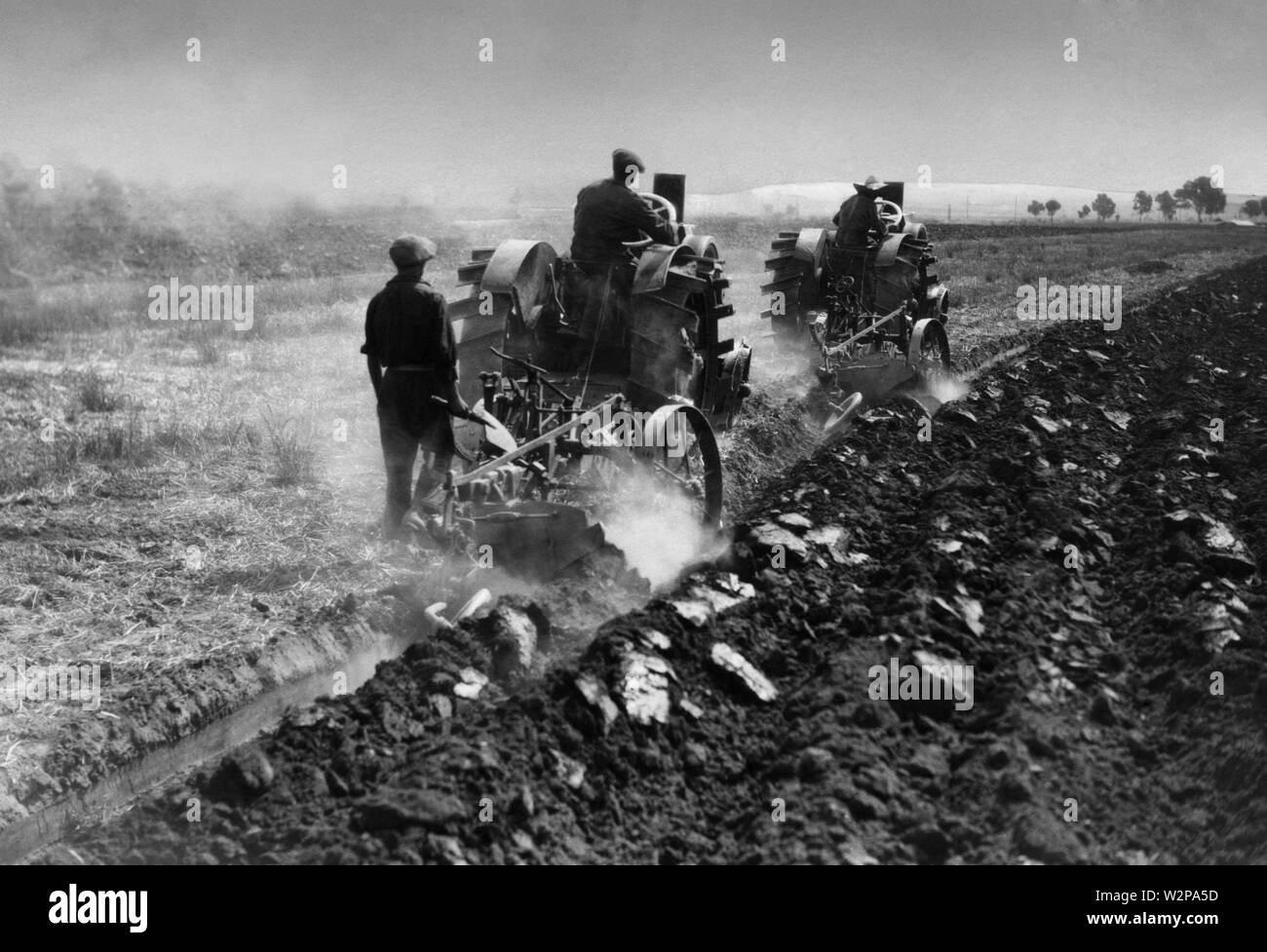 Lazio, plowing with tractors of reclaimed land, 1920-30 - Stock Image