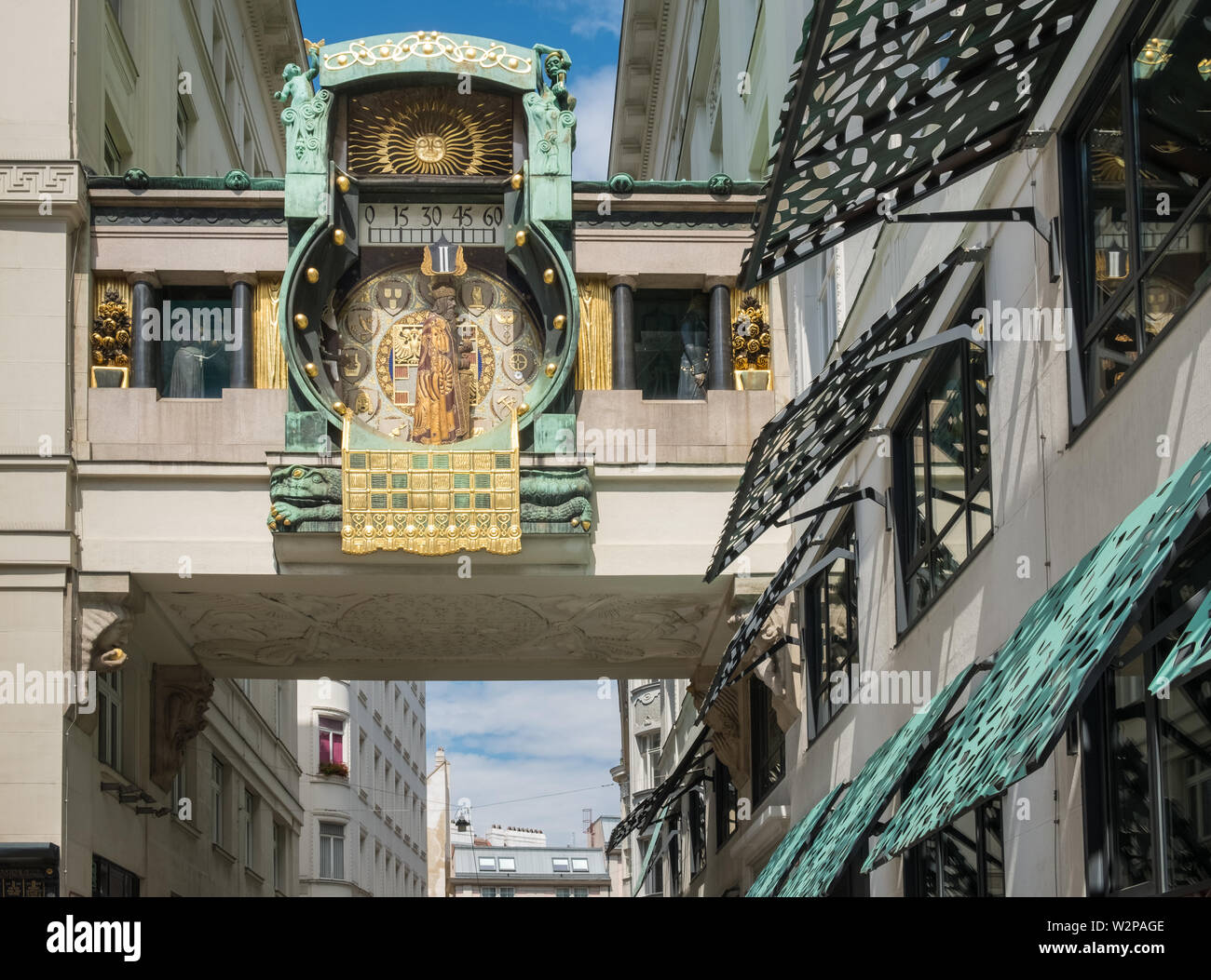 The Ankeruhr (Anchor clock), an Art Noveau mechanical clock built in 1914, that forms a bridge between two buildings, Hoher Markt, Vienna, Austria. Stock Photo