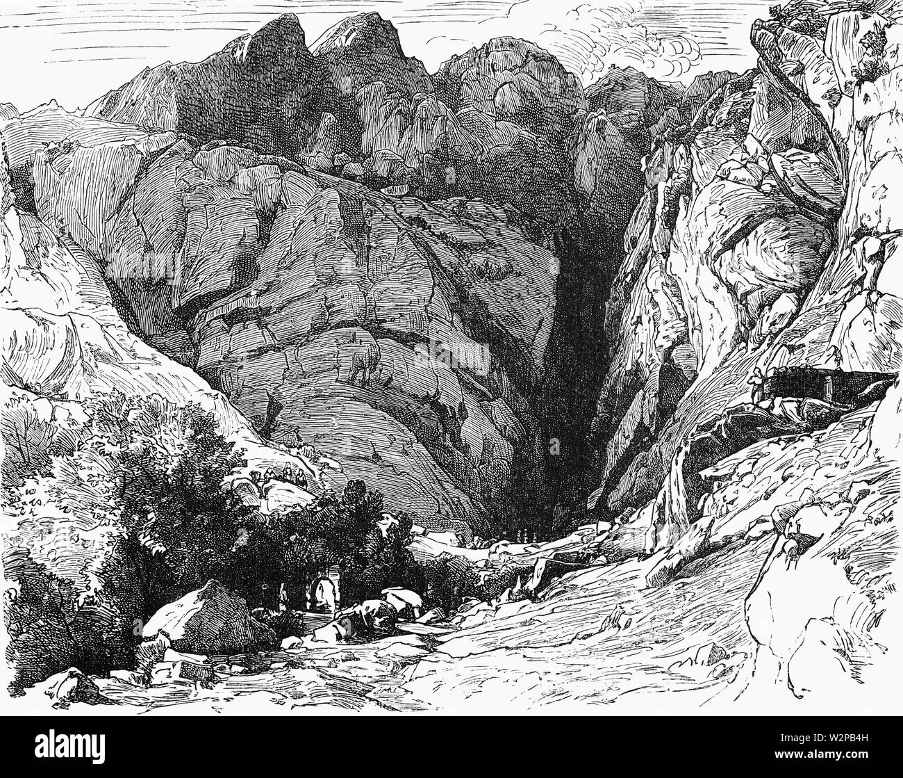 A view of the ravine at Delphi, where the sanctuary was attacked by the Gauls after they overran Macedonia  in 279 BCE . When the Gallic chieftain, Brennus, advanced through Macedonia to Greece he suffered heavy losses while trying to break through the Greek defense at the narrow pass of Thermopylae, on the east coast of central Greece. Eventually he found a way around the pass, but the Greeks escaped by sea. Brennus pushed on to Delphi, where he was wounded in battle and avoided capture by committing suicide. - Stock Image