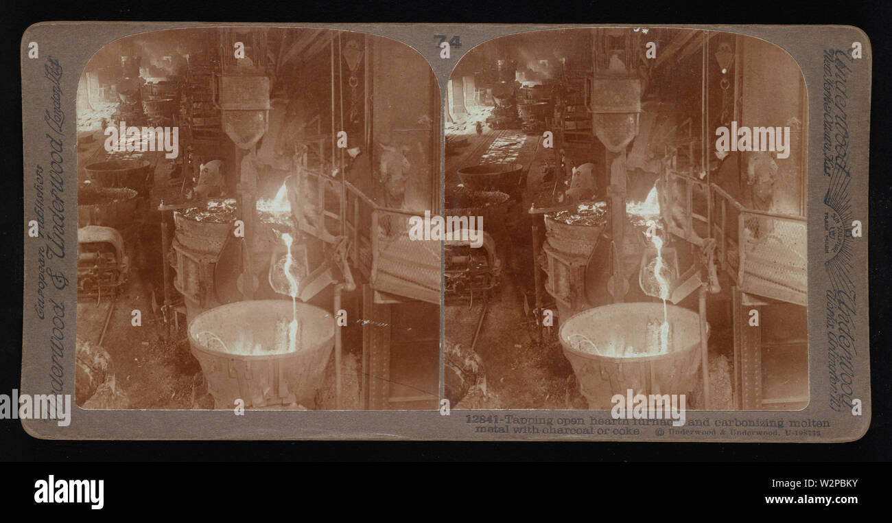 Tapping open hearth furnaces and carbonizing molten metal with charcoal or coke.; Underwood & Underwood Stereographs of Manufacturing Industries,  Set 5 - Making iron and steel by several processes,  Image 33 - Tapping open hearth furnaces and carbonizing molten metal with charcoal or coke.  These stereographs were created and sold as a set for educational use by Underwood & Underwood, a maker of stereoscopic images and equipment. This set was produced between 1895, when the educational unit was established, and 1921, when the company was sold. - Stock Image