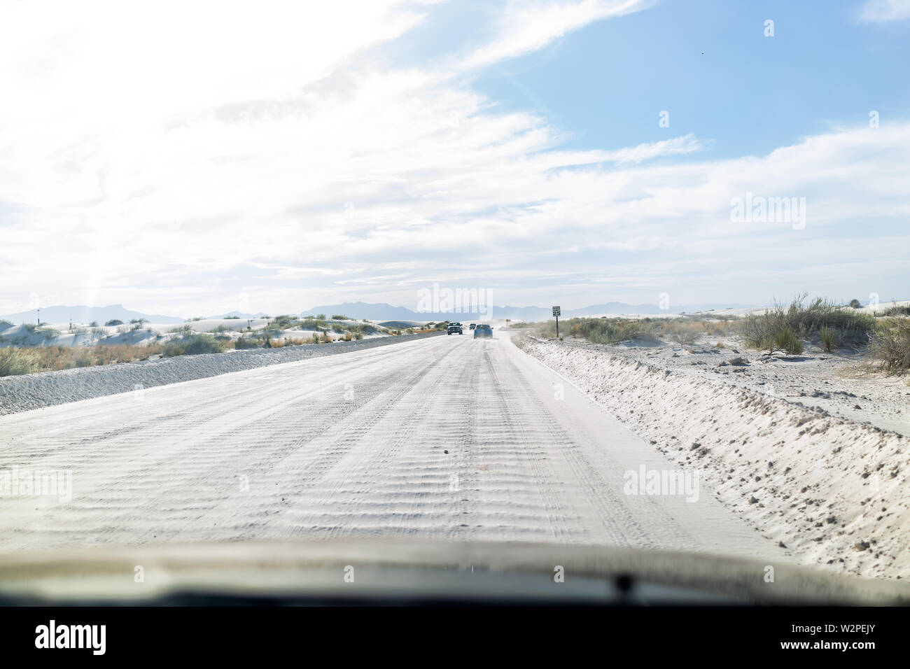 White sand dunes national monument road and cars in New Mexico driving to parking hiking trails - Stock Image