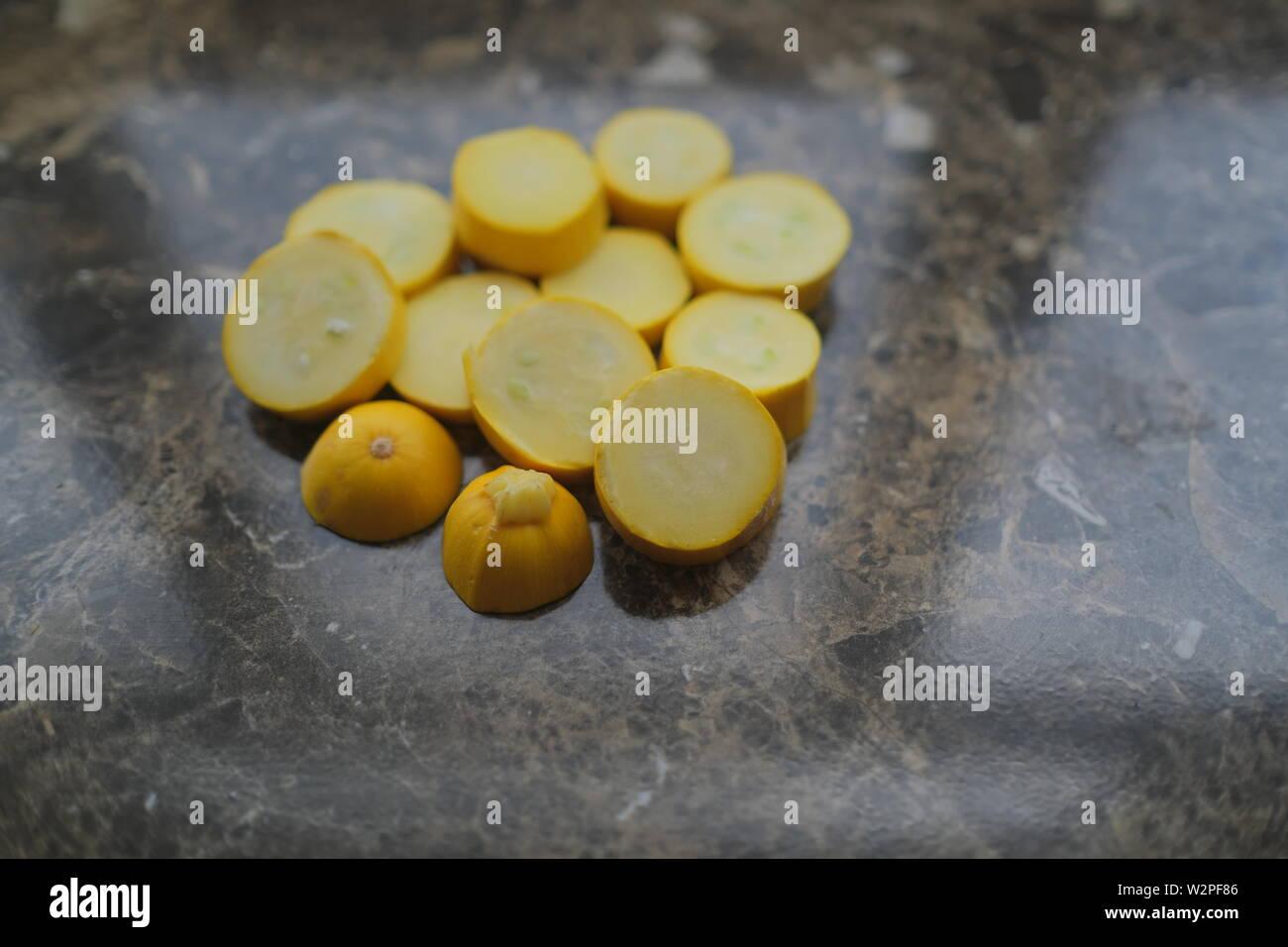 Yellow zucchini cut into circles - Stock Image