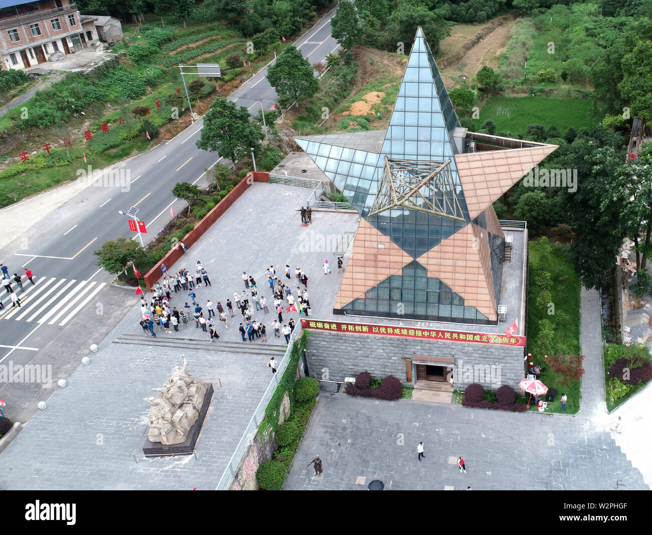 (190710) -- XING'AN, July 10, 2019 (Xinhua) -- Aerial photo taken on June 28, 2019 shows the memorial hall that commemorates the battle of Xinxu in Guanyang County, south China's Guangxi Zhuang Autonomous Region. The Battle of Xinxu was one of the three major block battles fought in Guangxi, which had brought time for the Red Army to cross the Xiangjiang River. Memorial halls and martyrs' cemeteries are springing up in many revolutionary places over the past few years, especially those along the Long March route. Visitors from all over China come to these memorials, reconnecting with histo - Stock Image