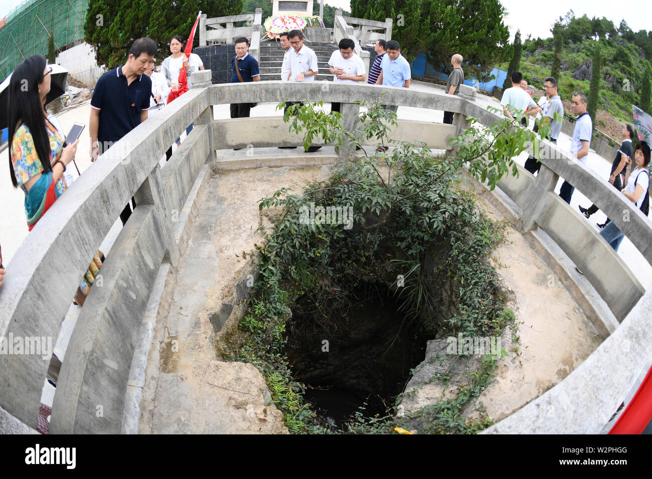 (190710) -- XING'AN, July 10, 2019 (Xinhua) -- Aerial photo taken on June 28, 2019 shows people touring the memorial garden that commemorates Red Army's soldiers who died in the battle of Xinxu in Guanyang County, south China's Guangxi Zhuang Autonomous Region. The Battle of Xinxu was one of the three major block battles fought in Guangxi, which had brought time for the Red Army to cross the Xiangjiang River. Memorial halls and martyrs' cemeteries are springing up in many revolutionary places over the past few years, especially those along the Long March route. Visitors from all over China - Stock Image