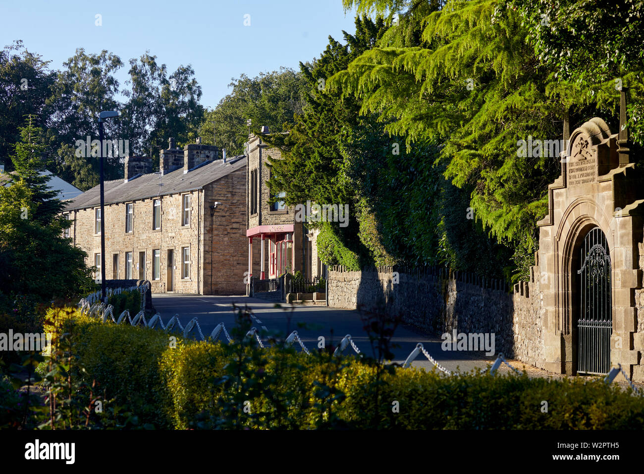 Waddington small picturesque village near Clitheroe in the Ribble Valley, Lancashire, grade II listed West wall, Waddington Hall with Iron gate - Stock Image