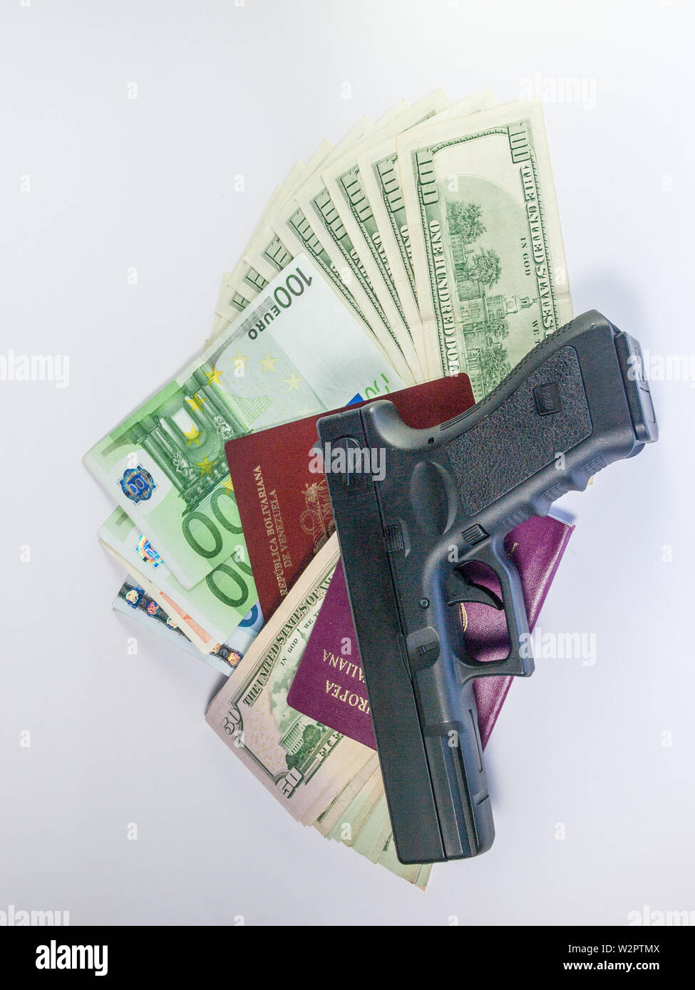 dollars and euro and passport - gangster terrorism - Stock Image