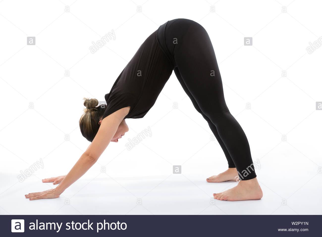 Adho Mukha Svanasana (Downward Dog pose). Yoga poses woman isolated with white background. Yoga pose set. Mindfulness and Spiritually concept. Girl pr - Stock Image