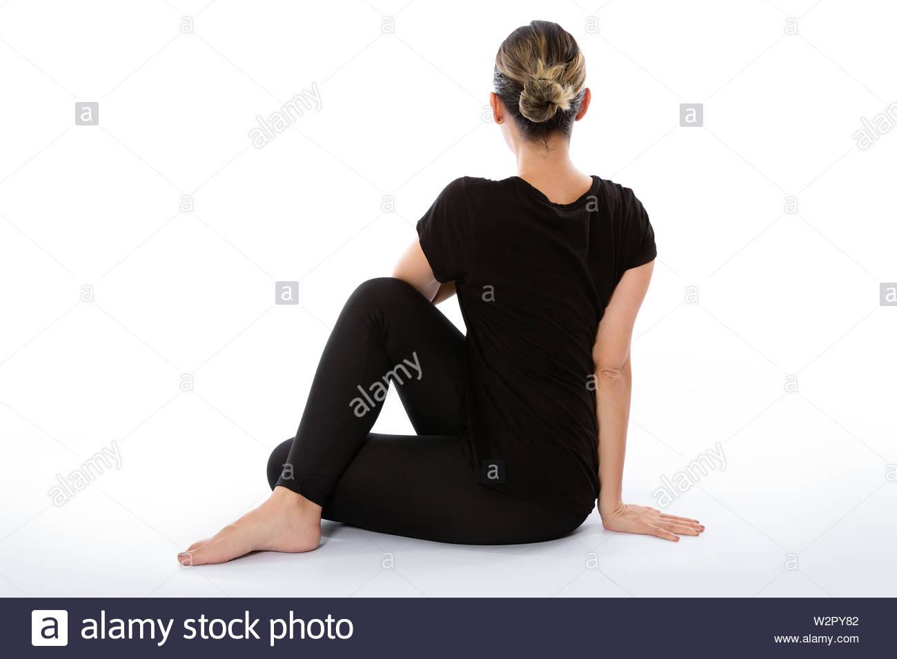 Ardha Matsyendrasana yoga pose (Seated spinal twist pose). Yoga poses woman isolated with white background. Yoga pose set. Mindfulness and Spiritually - Stock Image