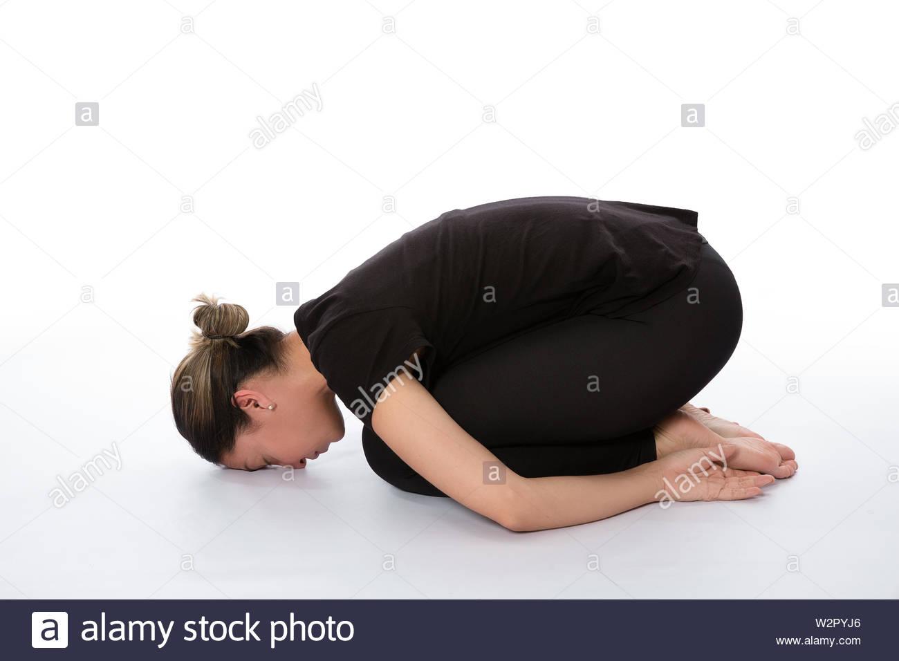 Balasana pose (Child pose). Yoga poses woman isolated with white background. Yoga pose set. Mindfulness and Spiritually concept. Girl practicing Hatha - Stock Image