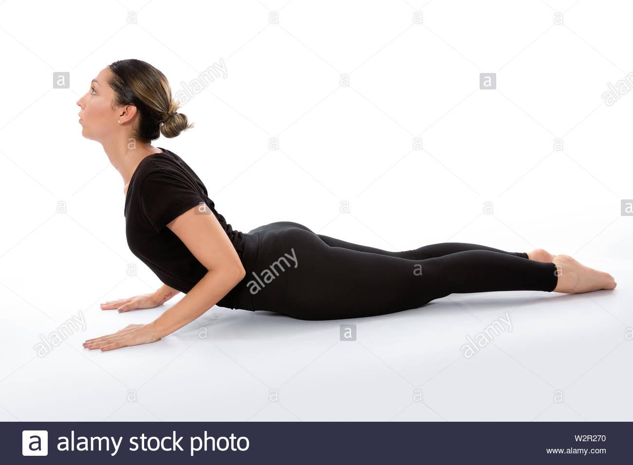 Bhujangasana (Cobra Pose). Yoga poses woman isolated with white background. Yoga pose set. Mindfulness and Spiritually concept. Girl practicing Hatha - Stock Image
